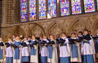 Lincoln Cathedral Choir against Deans' Eye Window backdrop